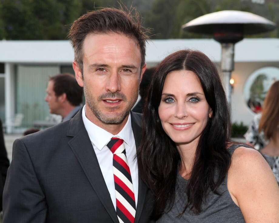 "David Arquette and Courtney Cox were one of our favorite odd couples. The two met making 1996's ""Scream"" and real life soon mirrored art when they became a couple and married at San Francisco's Grace Catherdral in 1999. The sitcom sweetheart and unpredictable funny-man filed for divorce in 2012, but through all of Arquette's drunken calls to Howard Stern and other antics, Cox has continued to defend the father of her child. Photo: Casey Rodgers, Associated Press"