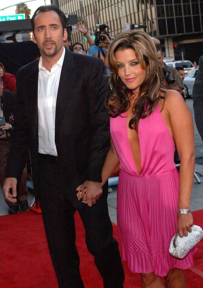 How could we not want something as weird as the 2002-2004 marriage of Elvis obsessed actor Nicholas Cage and Elvis spawn Lisa Marie Presley to work out? They were sort of a handsome couple together and, come on, they had a more natural chemistry on the red carpet than Presley had with her ex, one Mr. Michael Jackson. Photo: LUCY NICHOLSON, AFP/Getty Images