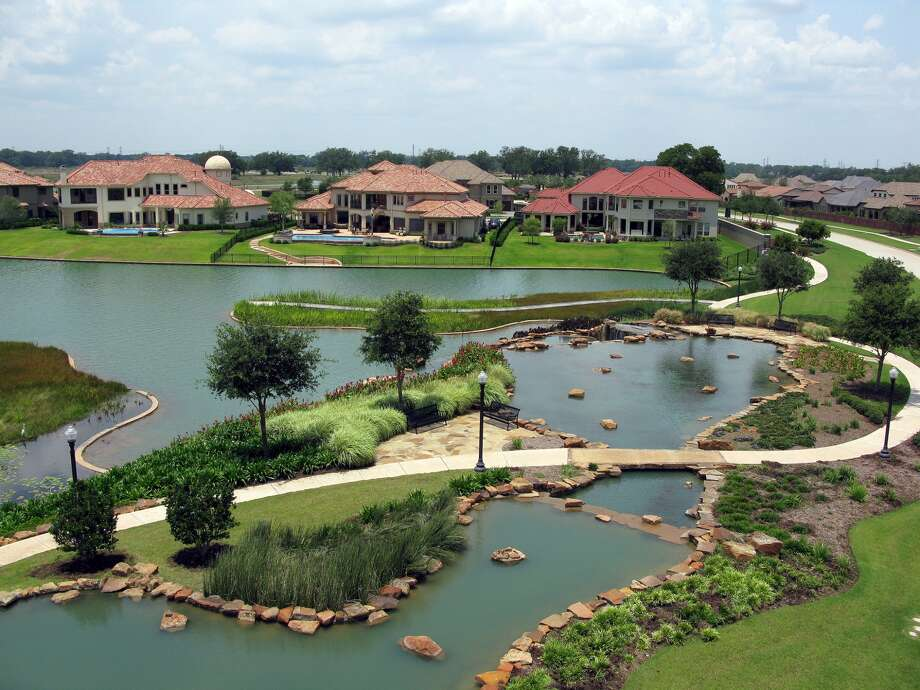 Waterways and trails are among the amenities residents enjoy in Fort Bend's Riverstone development. Photo: The Johnson Development Corp.