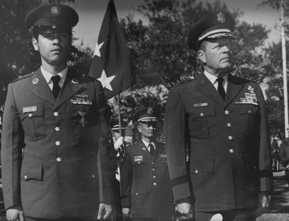 Spc. Santiago J. Erevia, left, stands by Lt. Gen. Harry Critz after receiving the Distinguished Service Cross for action in Vietnam in 1969.  Erevia will now receive the Medal of Honor. Photo: HO, Courtesy Photo / San Antonio Express-News