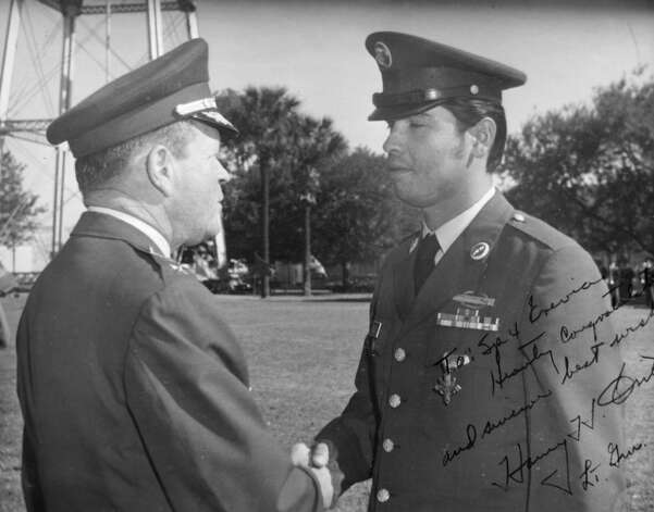 Spc. Santiago J. Erevia, right, is congratulated by Lt. Gen. Harry C. Critz after Erevia received the Distinguished Service Cross for action in Vietnam in 1969. Erevia will now receive the Medal of Honor the same action. Photo: HO, Courtesy Photo / San Antonio Express-News