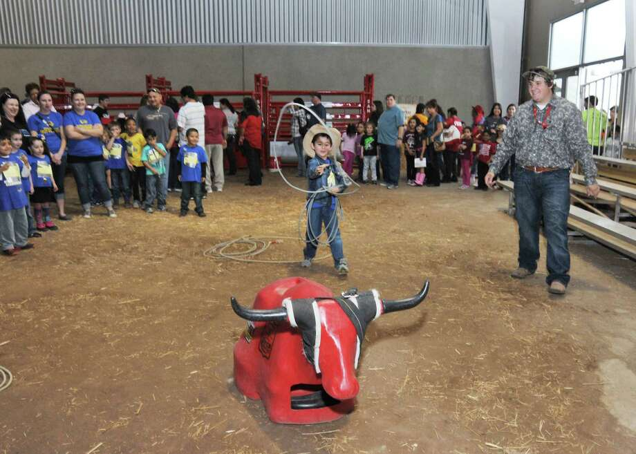 Five-year-old Remberto Castro, a Wiederstein Elementary student, lassos a calf during the Horse Experience at the 2014 San Antonio Stock Show and Rodeo at the AT&T Center. Photo: Courtesy Photo