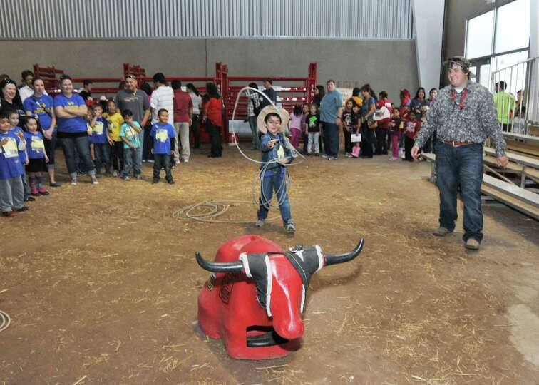 Five-year-old Remberto Castro, a Wiederstein Elementary student, lassos a calf during the Horse Expe