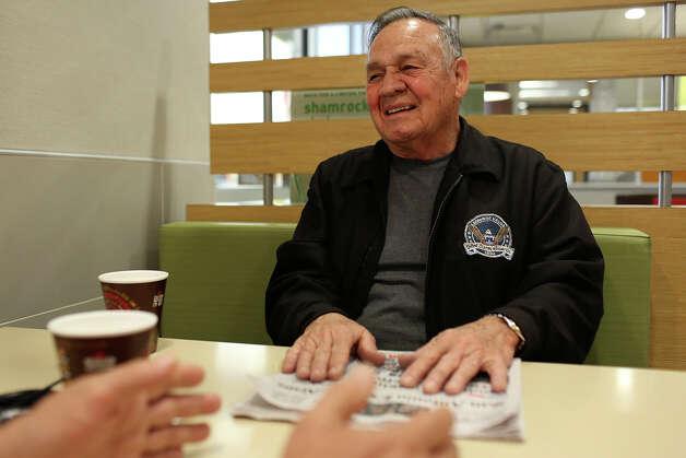 Medal of Honor recipient Jose Rodela, a retired Army Master Sergeant, has coffee at McDonald's with John Hix, a  Vietnam veteran and retired Marine, in San Antonio on Tuesday, Feb. 18, 2014. Photo: Lisa Krantz / San Antonio Express-News