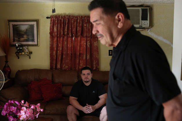 Medal of Honor recipient Santiago Erevia, a retired Army Sgt., spends the morning with his son, Roland Erevia, at his home in San Antonio on Tuesday, Feb. 18, 2014. Roland served three tours in Iraq with the Army. Photo: Lisa Krantz / San Antonio Express-News
