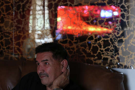 Medal of Honor recipient Santiago Erevia, a retired Army Sgt., watches the news, focusing on the violence in Ukraine, at his home in San Antonio on Tuesday, Feb. 18, 2014. Photo: Lisa Krantz / San Antonio Express-News