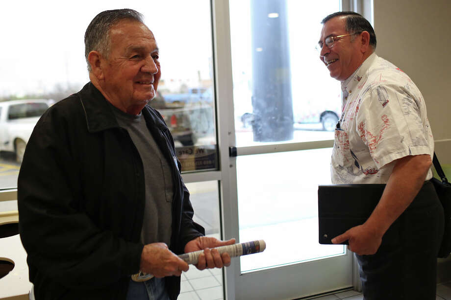 Medal of Honor recipient Jose Rodela, a retired Army Master Sergeant, says goodbye to John Hix, a Vietnam veteran and retired Marine, after having coffee together at McDonald's in San Antonio on Tuesday, Feb. 18, 2014. Photo: Lisa Krantz / San Antonio Express-News