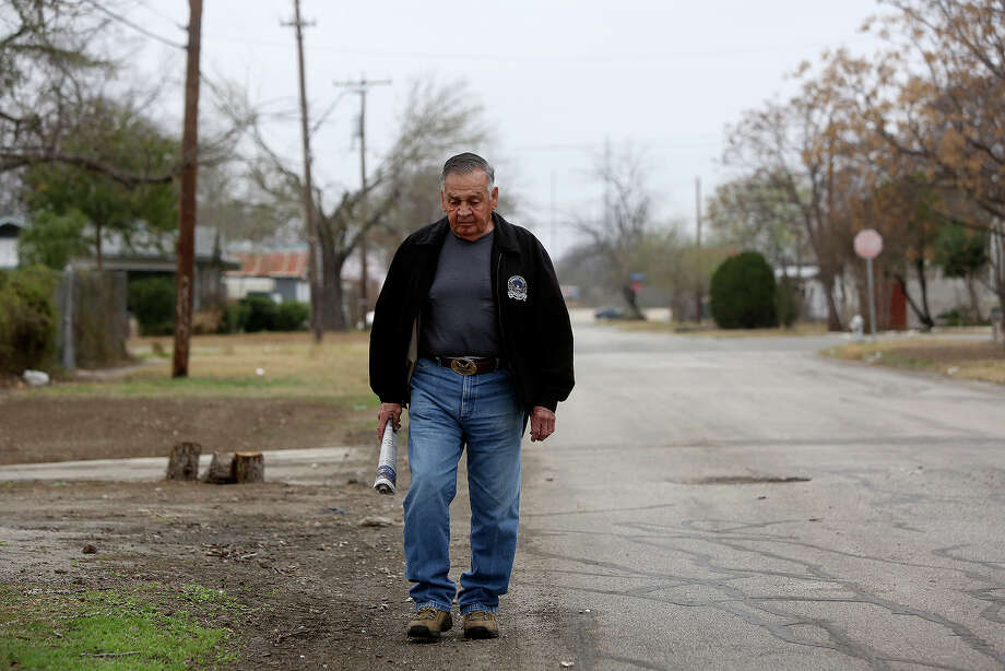 Medal of Honor recipient Jose Rodela, a retired Master Sergeant, walks home from having coffee at McDonald's with a friend in San Antonio on Tuesday, Feb. 18, 2014. Photo: Lisa Krantz / San Antonio Express-News