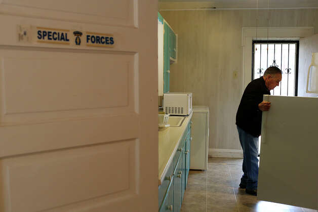 Medal of Honor recipient Jose Rodela, a retired Army Master Sgt., looks in his refrigerator at his home in San Antonio on Tuesday, Feb. 18, 2014. Photo: Lisa Krantz / San Antonio Express-News
