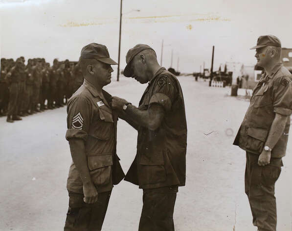 A photograph of Medal of Honor recipient Jose Rodela receiving a Purple Heart medal while serving in Vietnam on his first of two tours. Photo: Lisa Krantz / San Antonio Express-News