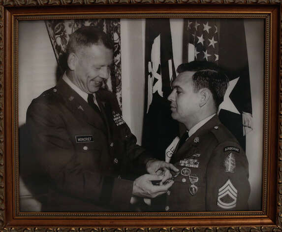 A photograph of Medal of Honor recipient Jose Rodela receiving the Distinguished Service Cross at Fort Sam Houston in 1969, at his home in San Antonio on Tuesday, Feb. 18, 2014. Photo: Lisa Krantz / San Antonio Express-News