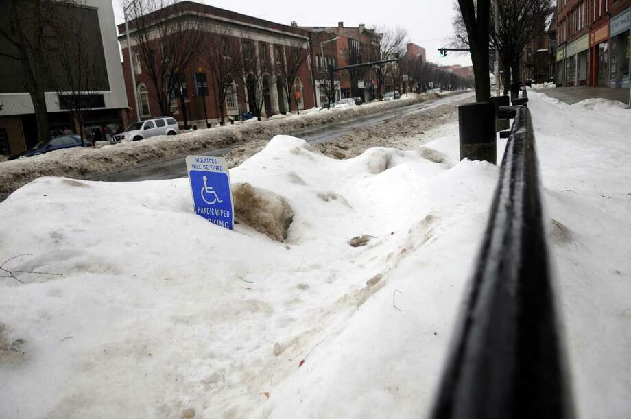 Merchants and office business owners on Main Street in Danbury, Conn. are complaining that huge mounds of snow still on their sidewalks is hindering their business, Friday, Feb. 21, 2014. Photo: Carol Kaliff / The News-Times
