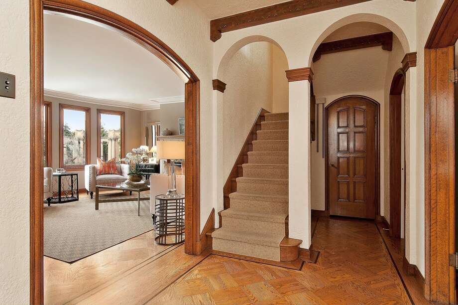 The foyer has a parquet floor and arched doorways. Photo: OpenHomesPhotography.com