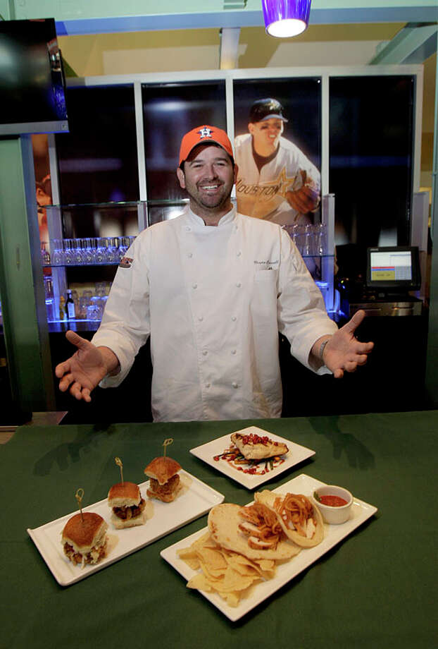 Sponsor Chef Bryan Caswell with Chicken fajitas with chips and salsa, Grilled Snapper Plantain and Long Bean Saute', Pomegrante Jus  and Bryan Caswell's Shroom Sliders, Beef Sliders with carmelized onions and Pulled Pork Slider with Creamy Cole Slaw are all part of the  food served at Minute Maid Park on the grill portable or in the 5-7 Bar and Resteraunt in Minute Maid Park in Houston, Texas. Special to the Chron: Thomas B. Shea Photo: Thomas B. Shea, For The Houston Chronicle / Freelance