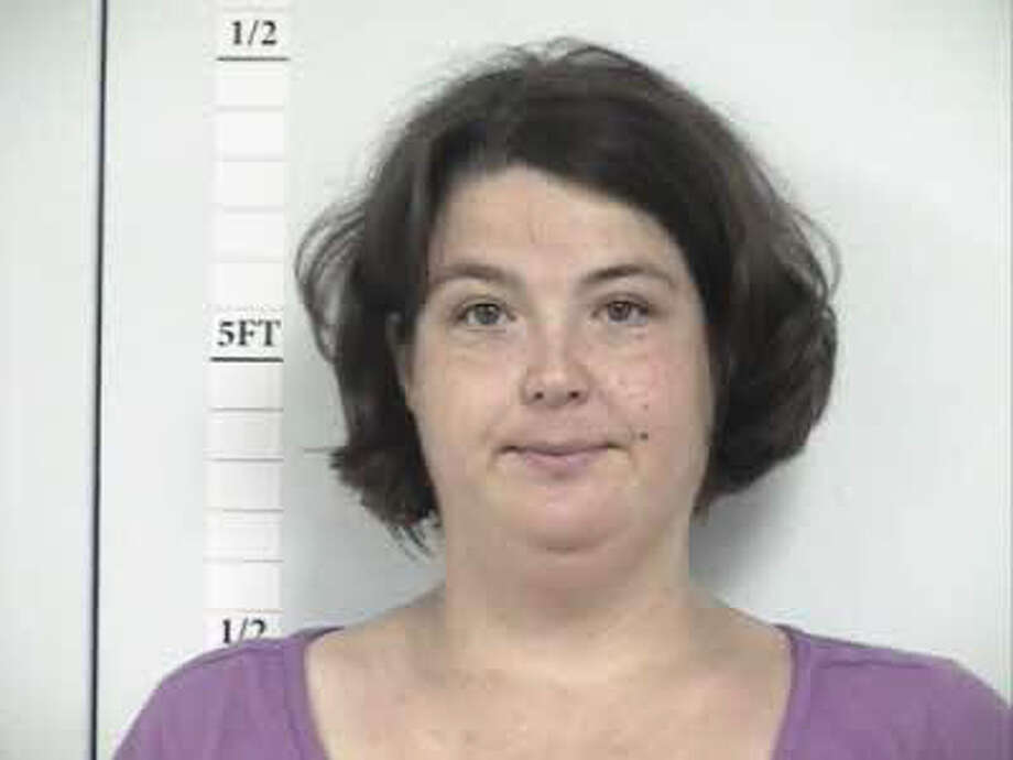 Trisha Lynn Dougia, 33, was charged with two counts of assaulting a public servant, a third-degree felony charge. Photo: Hardin County Sheriff's Office