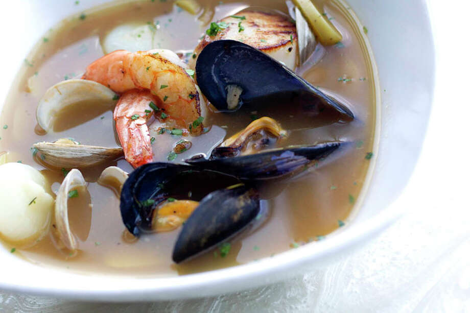 Bryan Caswell's hot pot of muscles, shrimp, clams and scallops at Reef Thursday, Sept. 1, 2011, in Houston. ( Johnny Hanson / Houston Chronicle ) Photo: Johnny Hanson, Houston Chronicle / © 2011 Houston Chronicle
