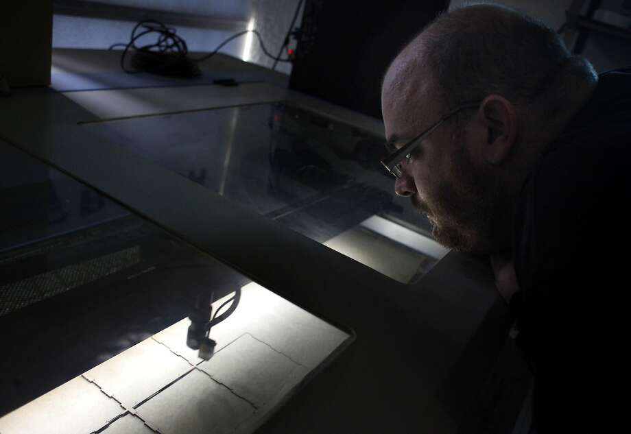 Marc Roth cuts cardboard with a laser at the TechShop in S.F. He used his $49 assistance check for a membership and within  16 months opened SF Laser. Now he wants to start a Learning Shelter program to help homeless people reap the same benefits. Photo: Lacy Atkins, The Chronicle