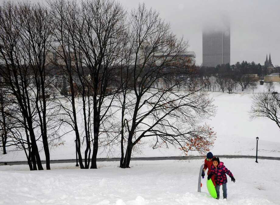 Thirteen-year-old Andre Massas and his 10-year-old sister Makiah Massas sled at Lincoln Park on Friday Feb. 21, 2014 in Albany, N.Y. (Michael P. Farrell/Times Union) Photo: Michael P. Farrell