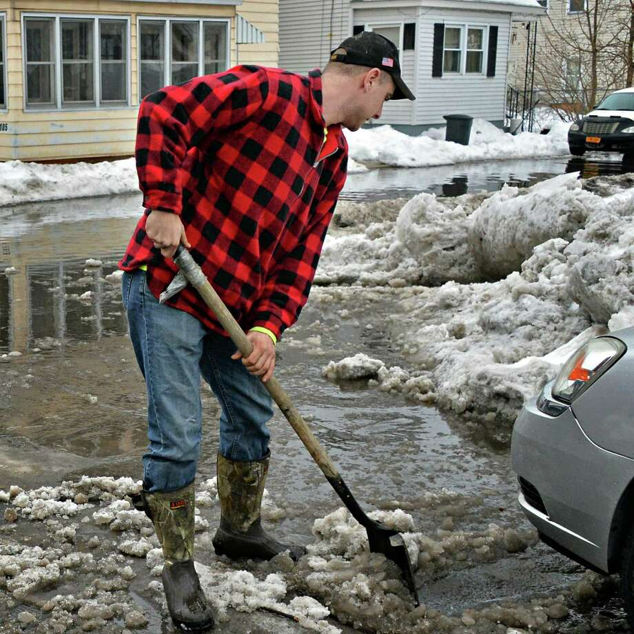 Water Dept. employee Dave Dressel clears snow blocking storm drains at 2nd Ave. and 4th St. Friday Feb. 21, 2014, in Watervliet, NY.  (John Carl D'Annibale / Times Union) Photo: John Carl D'Annibale