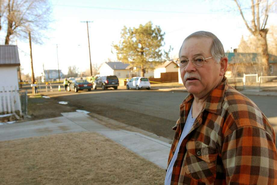 Retired county auditor Mike Tedrick stands on his front lawn with the Cedarville Rancheria tribal headquarters behind him, where the shooting occurred. Photo: Jeff Barnard, Associated Press