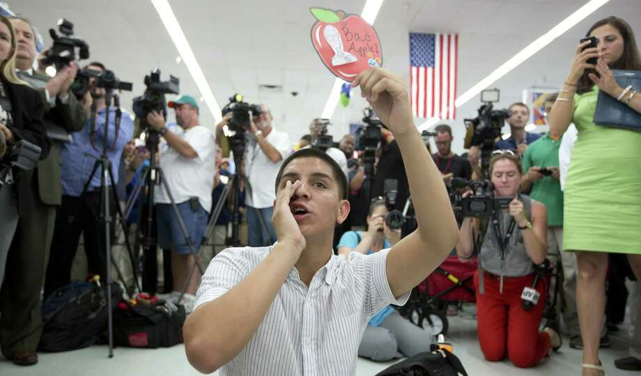 Jose Antonio Machado sat in the middle of a Walmart floor in Miami last summer, demanding that politicians get to work on   immigration reform. A reader agrees that it is time to fix immigration policies. Photo: J Pat Carter / Associated Press / AP