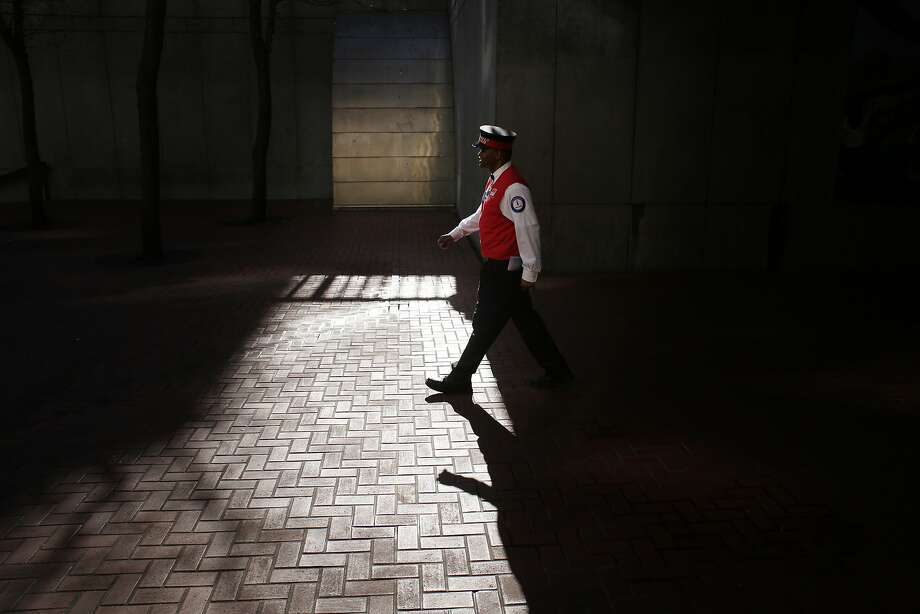 Wayne Alexis patrols near S.F.'s Powell Street BART Station. Photo: Mike Kepka, The Chronicle