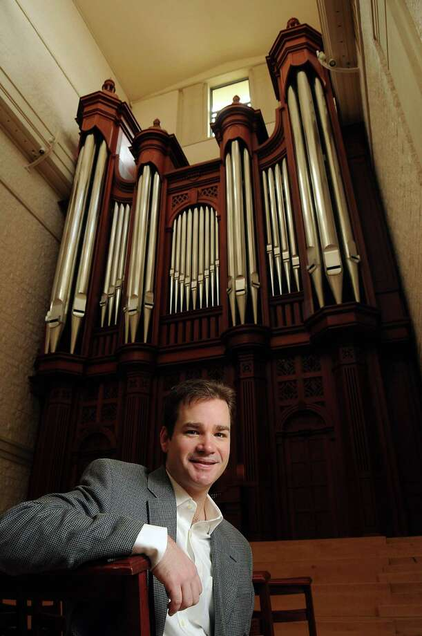 Kenneth Cowan, an organist who teaches in the Shepherd School of Music at Rice University stands with the pipe organ in  the Old Recital Hall on the Rice University Campus Sunday Feb 16, 2014.(Dave Rossman photo) Photo: Dave Rossman, Freelance / Freelance