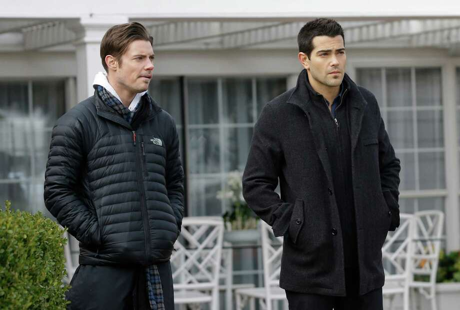 In this Wednesday, Feb. 5, 2014 photo, actors Josh Henderson, left, and Jesse Metcalfe rehearse a scene during production of the television series Dallas at Southfork Ranch in Parker, Texas. The third season of the reboot of the classic series, which premieres Monday, Feb. 24 on TNT, marks the first full season without Larry Hagman, who died of complications from cancer in November 2012 at age 81. (AP Photo/LM Otero) Photo: LM Otero, STF / AP