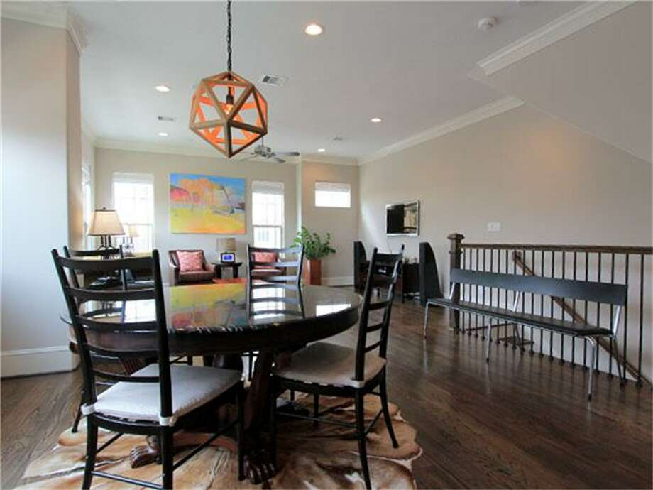 2437 Beall: This 2011 home has 3 bedrooms, 3.5 bathrooms, 2,141 square feet, and is listed for $409,900. Open house: 2/23/2014, 1 p.m. to 5 p.m. Photo: Houston Association Of Realtors