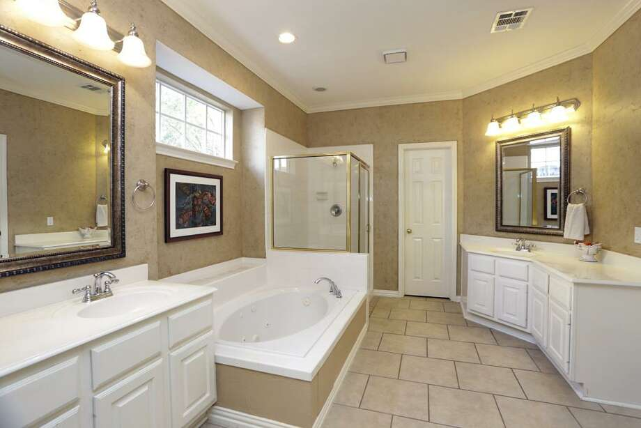 6326 Cool Water: This 1994 home has 4 bedrooms, 3.5 bathrooms, 3,054 square feet, and is listed for $325,900. Open house: 2/23/2014, 1 p.m. to 4 p.m. Photo: Houston Association Of Realtors