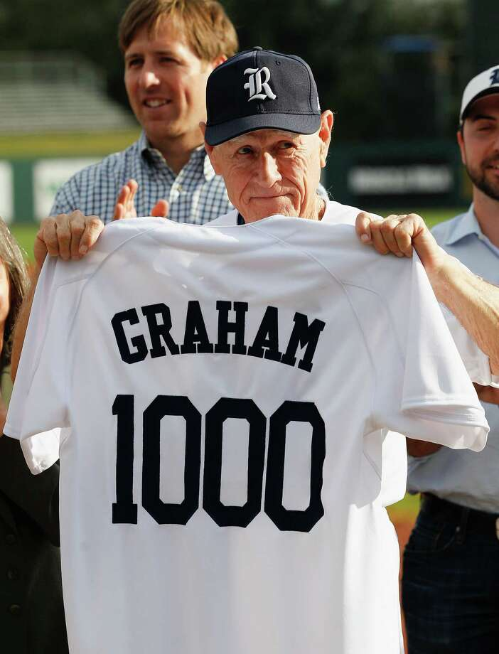 Rice Owls coach Wayne Graham holds up a jersey documenting his 1000th career win against Texas State on Feb. 18, 2014 before playing the Houston Cougars during an NCAA baseball game Wednesday, Feb. 19, 2014. Presenting the jersey was Joe Karlgaaard, Director of Athletics, Damon Thames, Lance Berkman and Tanya Graham. (Bob Levey/Special To The Chronicle) Photo: Bob Levey / ©2014 Bob Levey