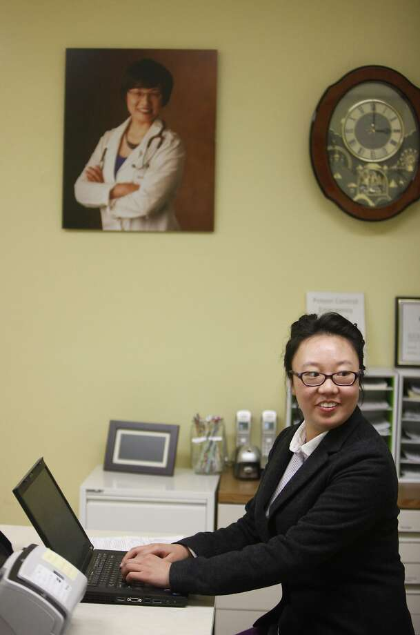 Wendy Liu works as an administrative assistant at her mother's pediatrics practice in Daly City. Photo: Lea Suzuki, The Chronicle