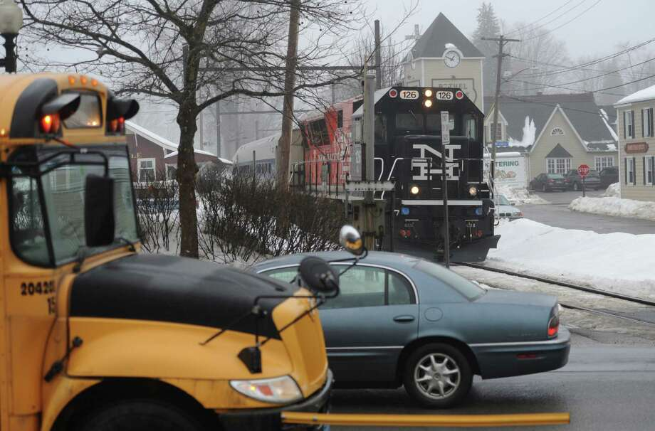 A Metro-North train bound for Danbury approaches Greenwood Avenue in Bethel, Conn. as traffic continues to cross the train tracks Friday, Feb. 21, 2014.  There have been reports of problems with the lights and safety arms at the train crossing in Bethel. Photo: Tyler Sizemore / The News-Times