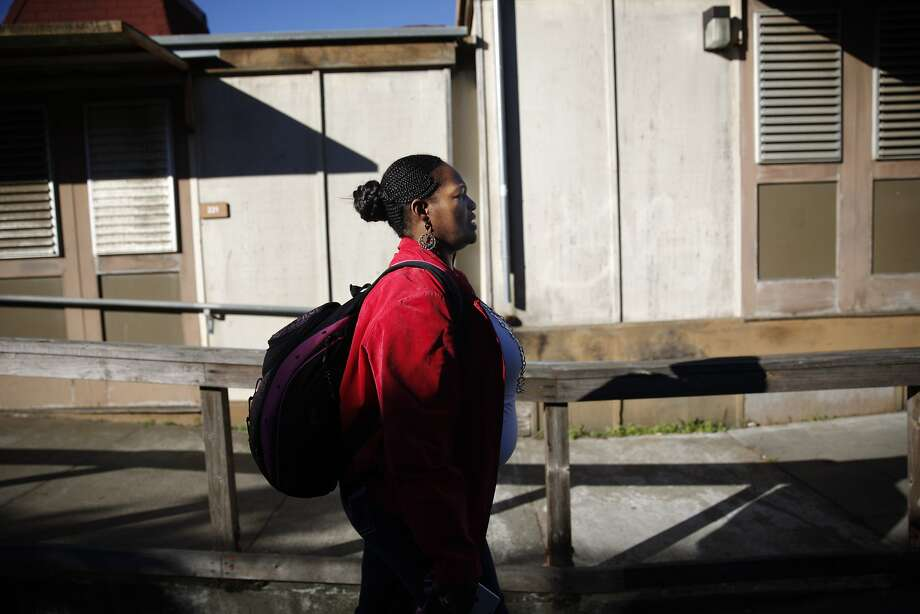 City College of San Francisco student Latonia Williams walks through campus to her CCSF acting class on Wednesday, January 22, 2014 in San Francisco, Calif. Photo: Lea Suzuki, The Chronicle