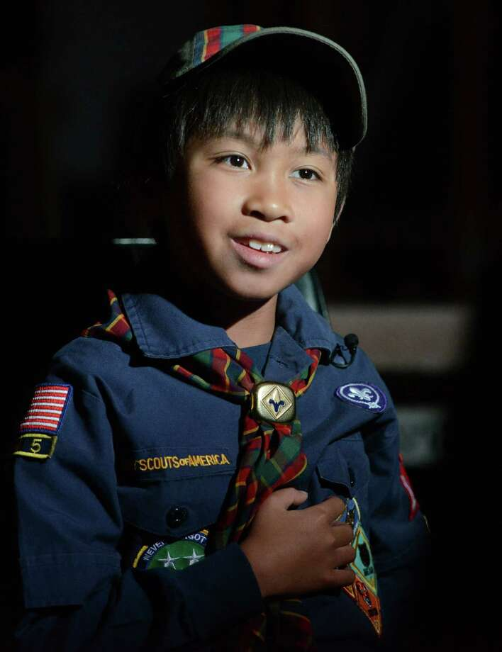 Edwin Tout, a fourth-grader at Sandy Hook Elementary School, gets interviewed in Sandy Hook, Conn. Friday, Feb. 21, 2014.  Tout was selected to be among a delegation of only nine Scouts across the country who are getting an inside look of Washington, D.C.  He left for Washington on February 22 and will present the Boy Scouts of America's annual report to Speaker of the House John Boehner and other congressional leaders. Photo: Tyler Sizemore / The News-Times