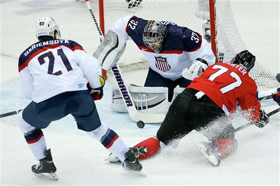 Jonathan Quick of the United States makes a save vs. Canada. Quick is a Milford native who went to Hamden High School and Avon Old Farms