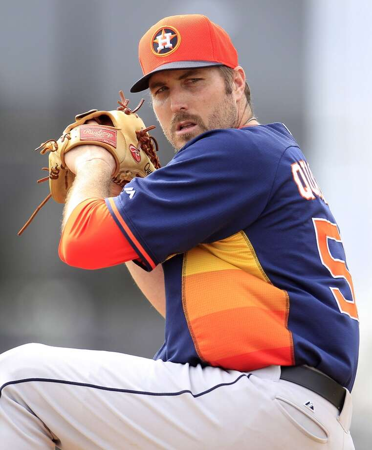 Astros pitcher Chad Qualls tosses a pitch during spring training workouts. Photo: Karen Warren, Houston Chronicle