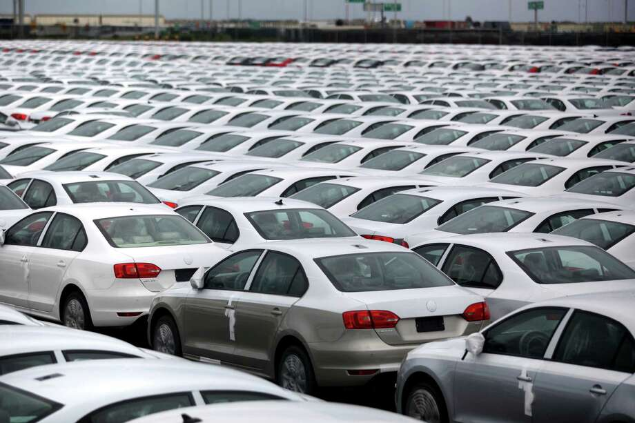 FILE - In this Sept. 19, 2013 file photo, Volkswagen Jettas produced in Mexico for export are parked at the port terminal in the Gulf city of Veracruz, Mexico. Mexico is on track to replace Japan as the second-largest exporter of cars to the United States by the end of 2014, and is expected to surpass Canada for the top spot by the end of 2015. (AP Photo/Felix Marquez, File) ORG XMIT: XLAT115 Photo: Felix Marquez / AP