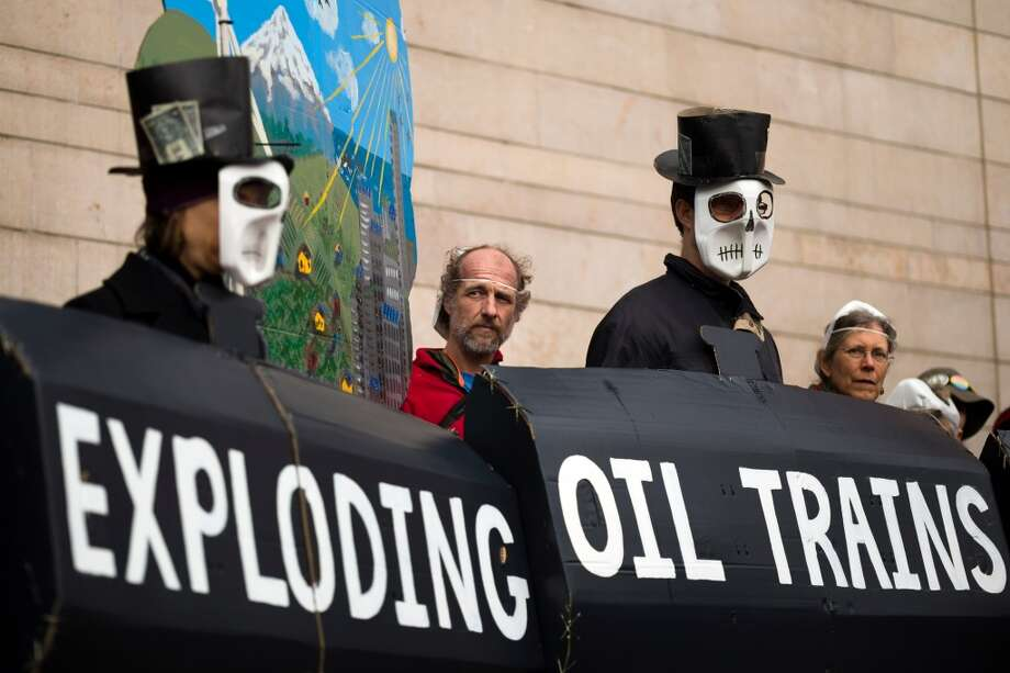 Concerned citizens rally for the need of a statewide moratorium on potentially dangerous oil-by-rail projects Friday, Feb. 21, 2014, at City Hall in Seattle. Oil trains have exploded in different regions in the U.S., causing death and property damages. (Jordan Stead, seattlepi.com) Photo: SEATTLEPI.COM
