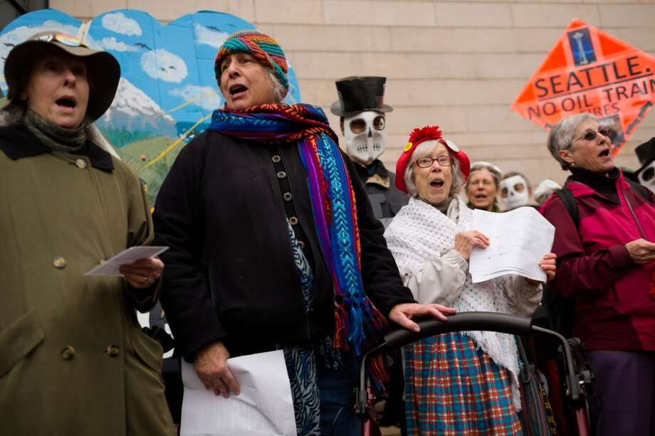 Members of the Seattle Raging Grannies perform during a rally for the need of a statewide moratorium on potentially dangerous oil-by-rail projects Friday, Feb. 21, 2014, at City Hall in Seattle. Oil trains have exploded in different regions in the U.S., causing death and property damages. (Jordan Stead, seattlepi.com) Photo: SEATTLEPI.COM