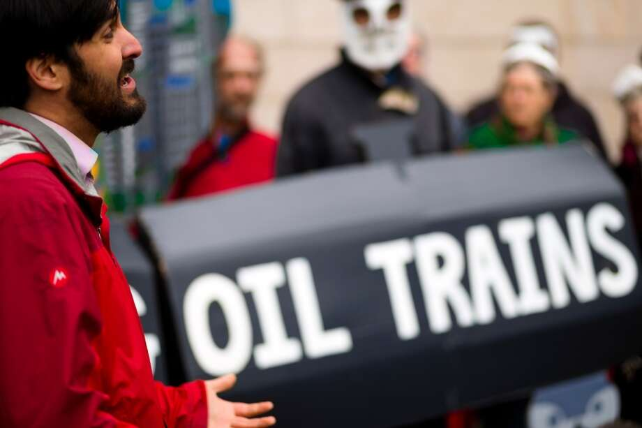 Adam Gaya, left, speaks with concerned citizens during a rally for the need of a statewide moratorium on potentially dangerous oil-by-rail projects Friday, Feb. 21, 2014, at City Hall in Seattle. Oil trains have exploded in different regions in the U.S., causing death and property damages. (Jordan Stead, seattlepi.com) Photo: SEATTLEPI.COM