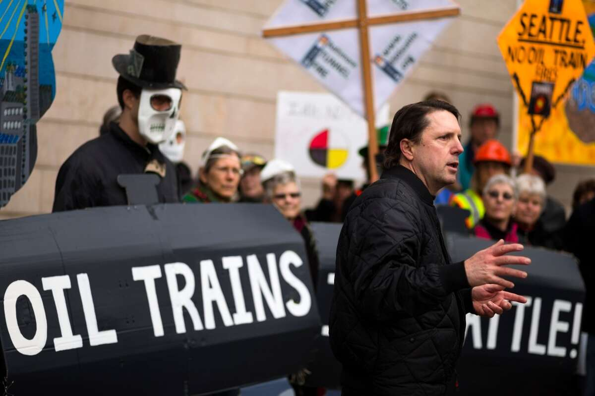 Oil trains have drawn protests across Washington, here in 2014 outside Seattle City Hall. The state's energy siting council has just recommended against construction of a big oil-by-rail terminal along the Columbia River in Vancouver.
