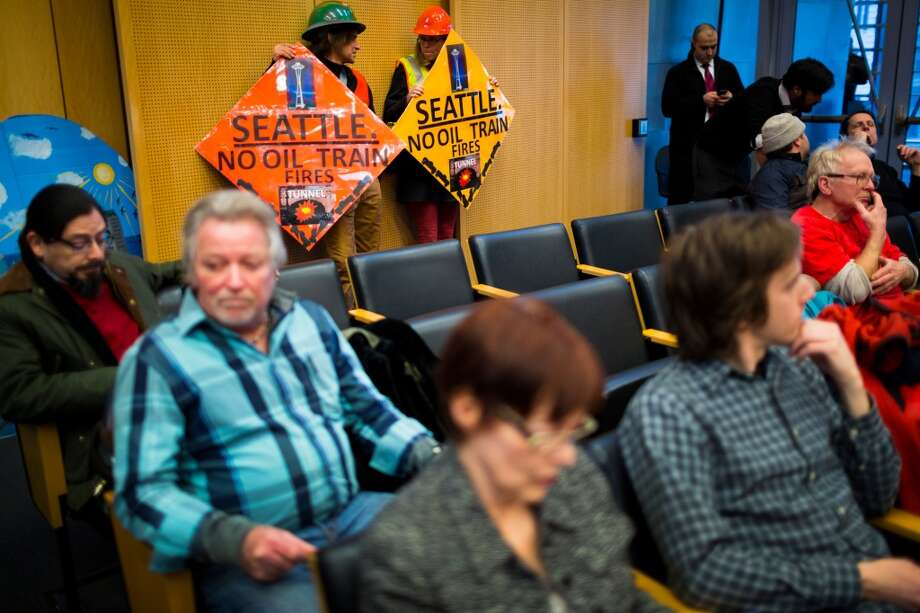 Concerned citizens fill the Seattle City Council's chambers following a rally for the need of a statewide moratorium on potentially dangerous oil-by-rail projects Friday, Feb. 21, 2014, at City Hall in Seattle. Oil trains have exploded in different regions in the U.S., causing death and property damages. (Jordan Stead, seattlepi.com) Photo: SEATTLEPI.COM