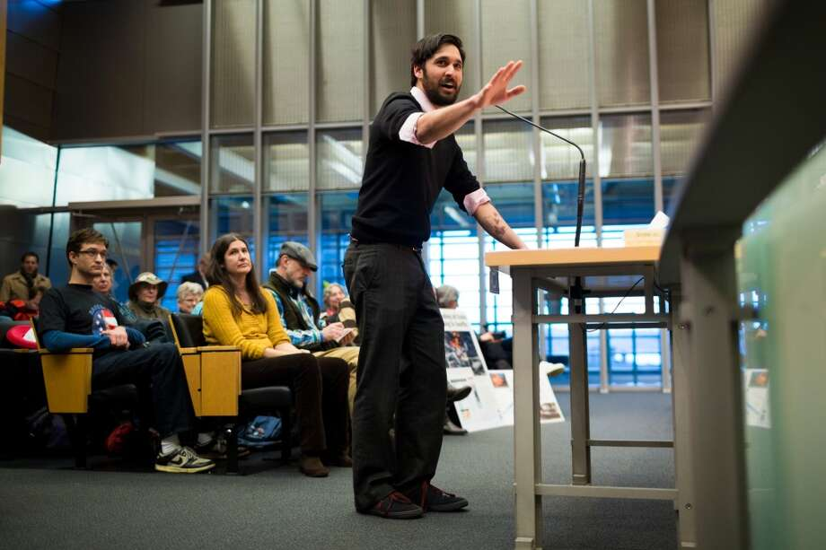 Adam Gaya addresses the Seattle City Council following a rally for the need of a statewide moratorium on potentially dangerous oil-by-rail projects Friday, Feb. 21, 2014, at City Hall in Seattle. Oil trains have exploded in different regions in the U.S., causing death and property damages. (Jordan Stead, seattlepi.com) Photo: SEATTLEPI.COM