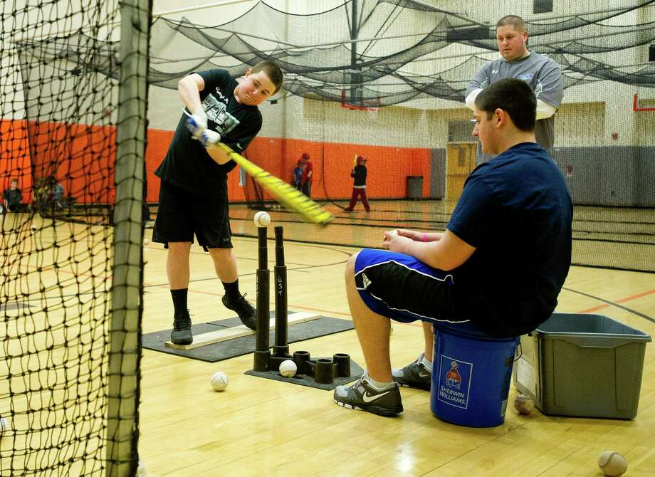 Zac Feinstein, 13, practices hitting the ball during the last day of EST Baseball's week-long Winter Hitting, Speed and Agility Clinic at Stamford High School on Friday, February 21, 2014. Photo: Lindsay Perry / Stamford Advocate