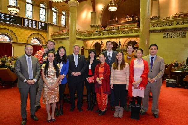 """The state Assembly conducted an Asian Lunar New Year celebration on Tuesday, Feb. 11. Certificates were presented to several students who were a part of the TESOL China-U.S. exchange program at St. John's University. Certificates were also presented to educators and others for their contributions to the state?s Asian American community. The Lunar New Year in 2014 marks the Year of the Horse on the Asian Lunar calendar. The event was celebrated with traditional food, a """"year of the horse"""" cake-cutting, Asian lanterns and decorations. (Submitted photo)"""