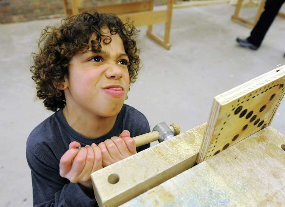 Corey da Silva, 10, of Poestenkill uses everything he's got to loosen a piece of wood from a vice during a woodworking class at The Arts Center on Friday, Feb. 21, 2014, in Troy, N.Y. Winter break camps at The Arts Center are in session for elementary, middle and high school students.  (Lori Van Buren / Times Union) Photo: Lori Van Buren / 00025846A