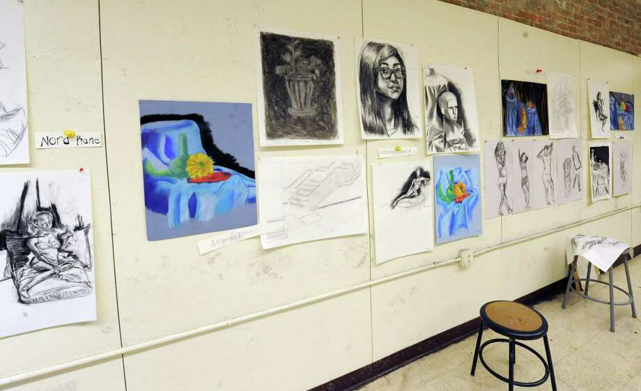 Art work from high school students hang on a wall in one of the drawing classes at The Arts Center Friday, Feb. 21, 2014, in Troy, N.Y. Winter break camps at The Arts Center are in session for elementary, middle and high school students.  (Lori Van Buren / Times Union) Photo: Lori Van Buren / 00025846A
