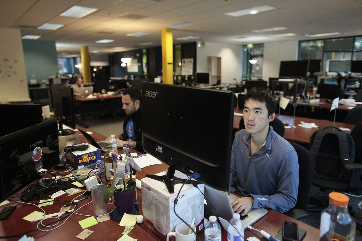 Elliot Lui of Travelnuts sits at his workspace at StartX in Mountain View, Calif. on Friday, Feb. 21, 2014. StartX has helped churn out more than 150 companies from Stanford University in the past five years.