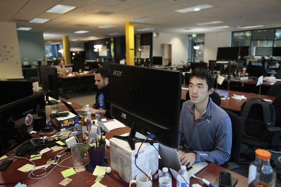 Elliot Lui of Travelnuts sits at his work space at StartX. More than 150 companies have gone through the incubator. Photo: James Tensuan, Special To The Chronicle